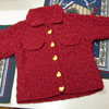 Finished Cabled Baby Jacket (and mittens, and a little ornament)